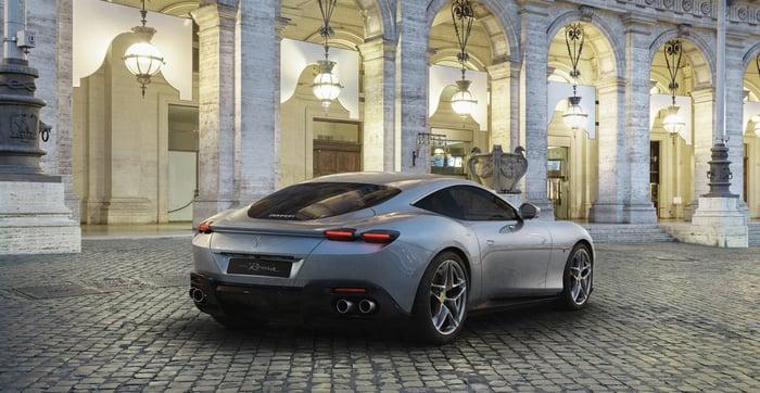 A silver Ferrari Roma, a sleek front-engined grand touring car.