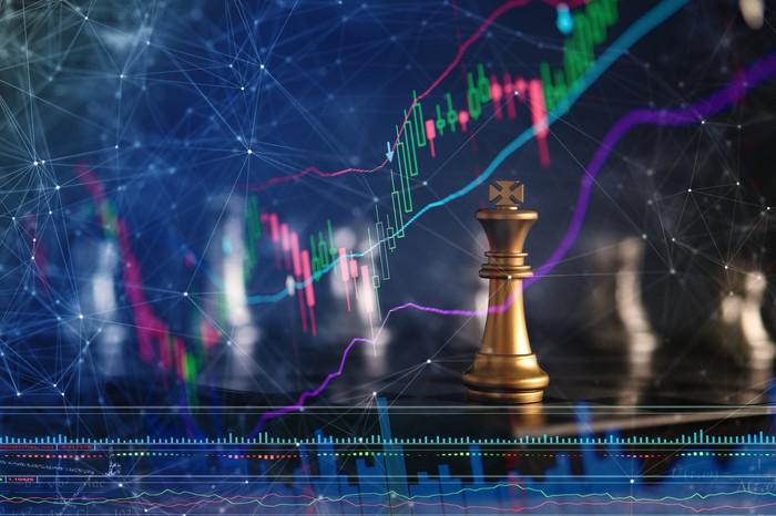 Dividend King concept with a golden chess king in front of a rising stock or dividend chart.