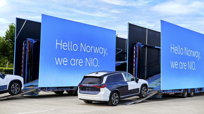 Nio electric vehicles being loaded for delivery to Norway.
