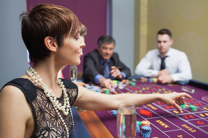 Gamblers playing roulette.