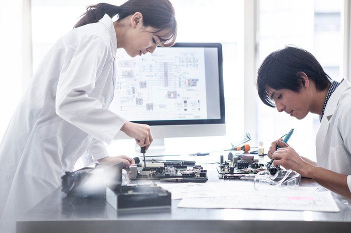 Two researchers in an office working on semiconductors.