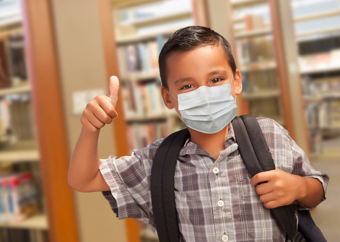Young student wearing a mask.