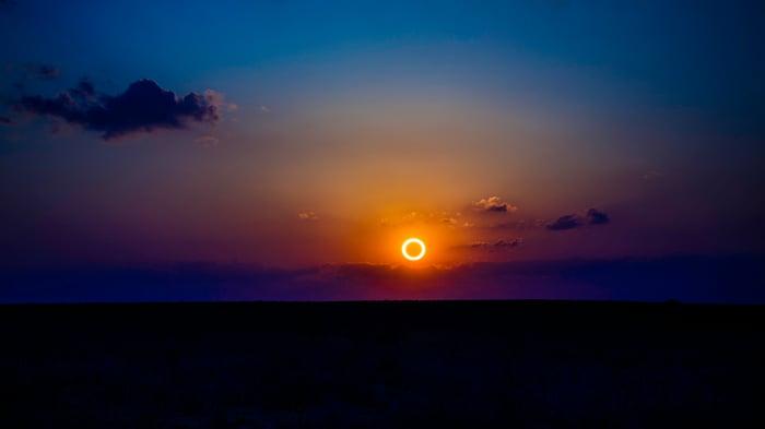 Solar eclipse low on the horizon