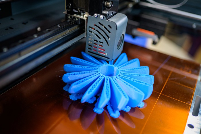 3D printed part being made in a printer.