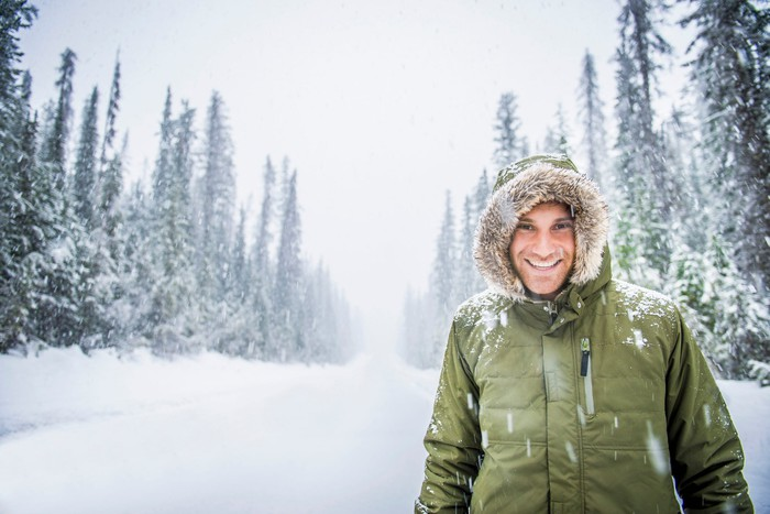 A person wearing a down coat in a snowy landscape.