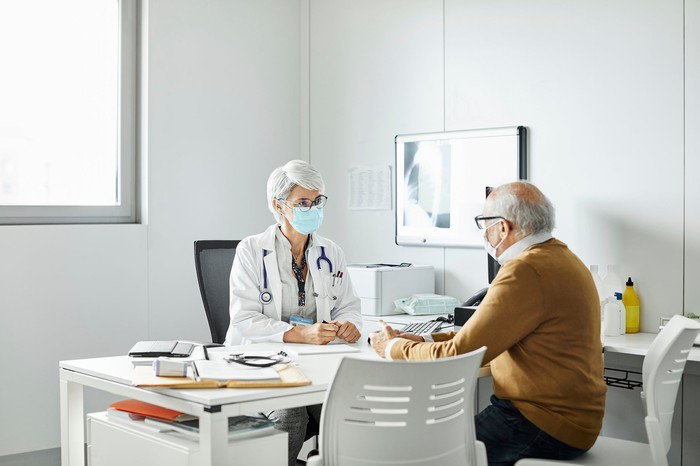 A doctor and patient meet for an appointment.