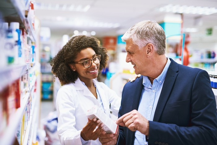 Pharmacist helping a customer.
