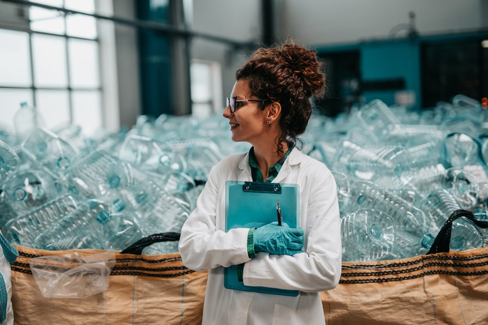 A worker in a plastic bottle recycling facility.