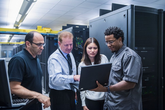 Colleagues working together in a data center.