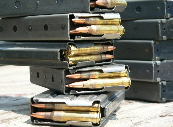 A stack of M4 or AR15 magazines loaded with 5.56x45mm ammunition.