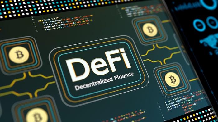 DeFi and Bitcoin logo imprinted on a circuit board.
