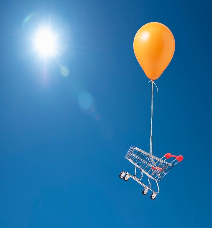 Balloon carrying shopping cart.