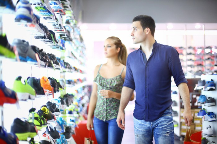 People shopping in a sneaker store.