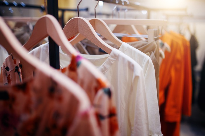Colorful shirts hanging on a rack.