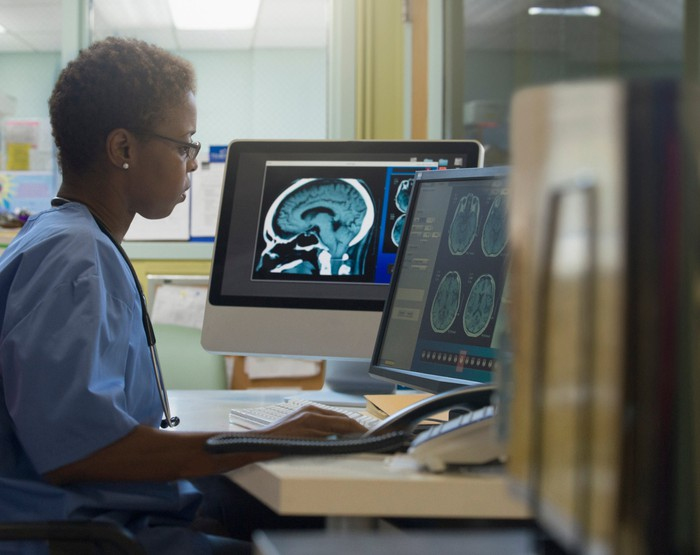 Doctor at a computer.