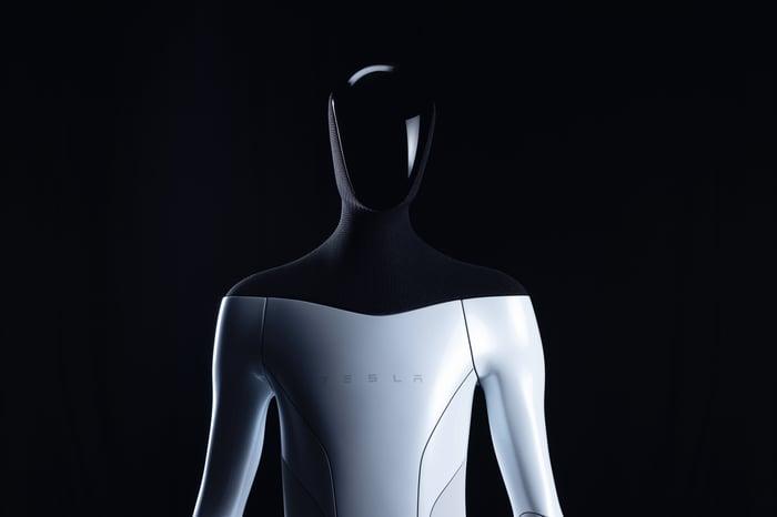 The Tesla Bot against a black background.
