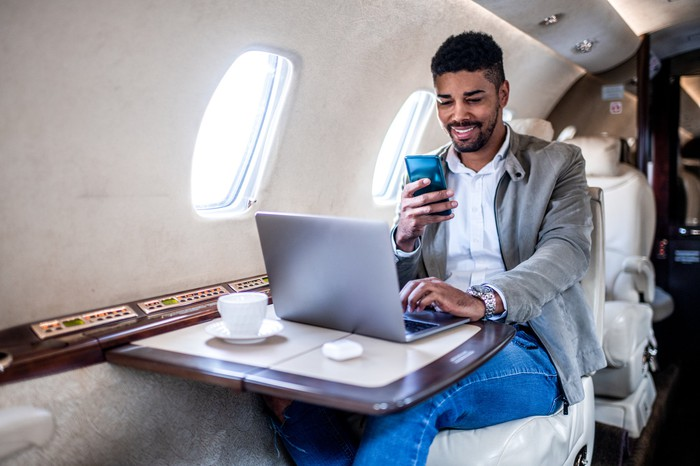 A person working while on a private jet.