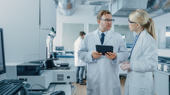 Two researchers in a pharmaceutical manufacturing facility.