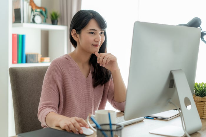 Person seated at a desk using a PC.