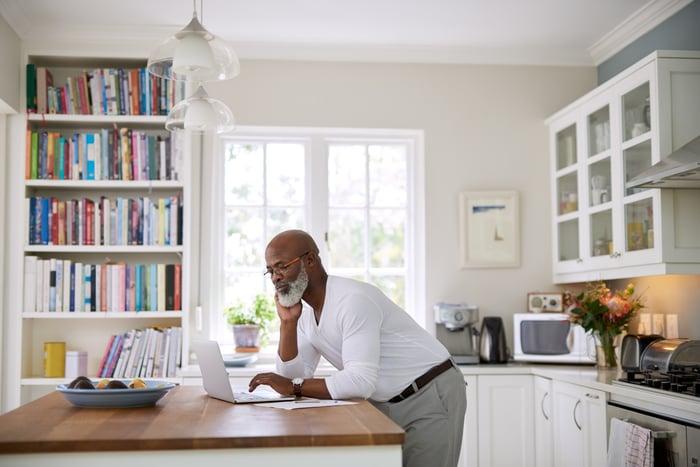 Man looking at his laptop.