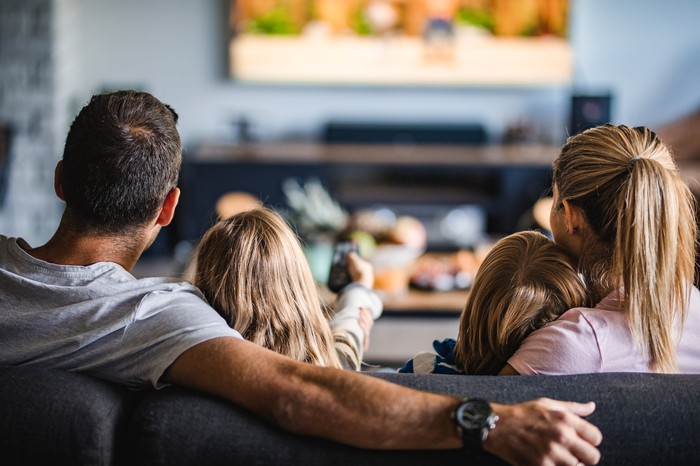 A family watching tv .