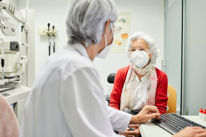 An elderly patient meets with their doctor for an appointment.