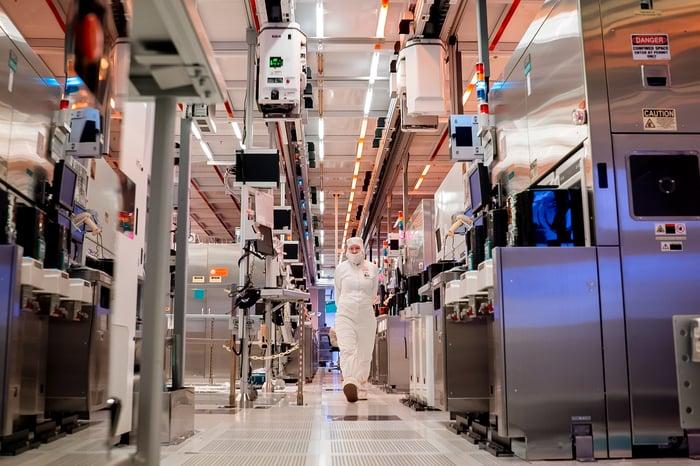 An Intel employee walks through a fabrication plant.