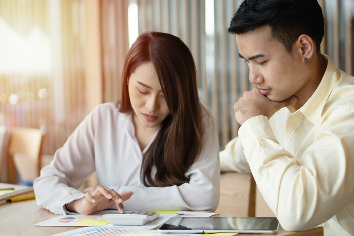 Couple reviewing financial documents.