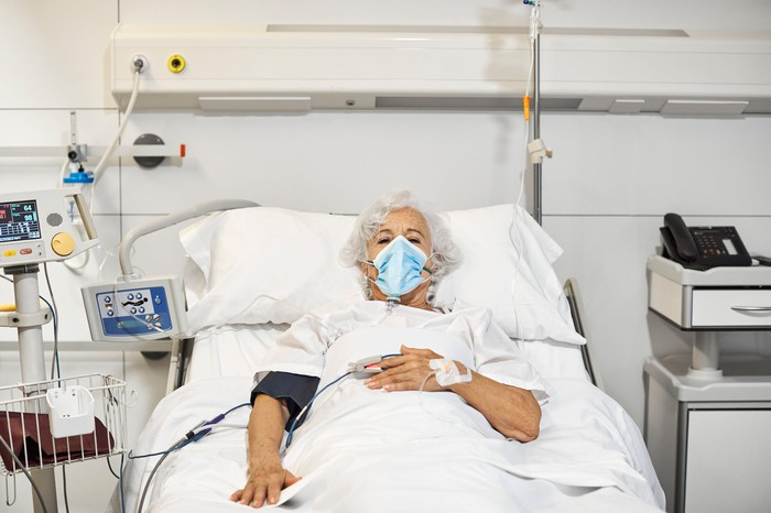 Patient in a hospital bed.