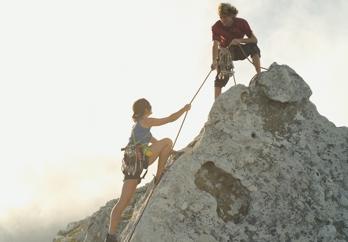 Two mountain climbers at the summit.