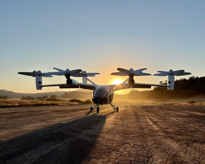 Joby electric vertical takeoff and landing aircraft backed by a rising sun.