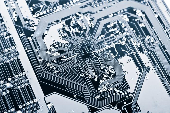 Closeup of transistors on a printed circuit board.