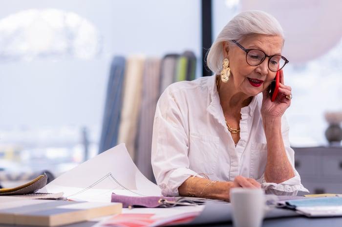 Senior worker talking on phone.