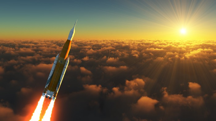 The sun and a rocket blasting above the clouds.