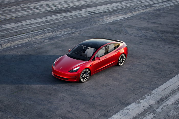 An overhead view of a red Tesla Model 3.