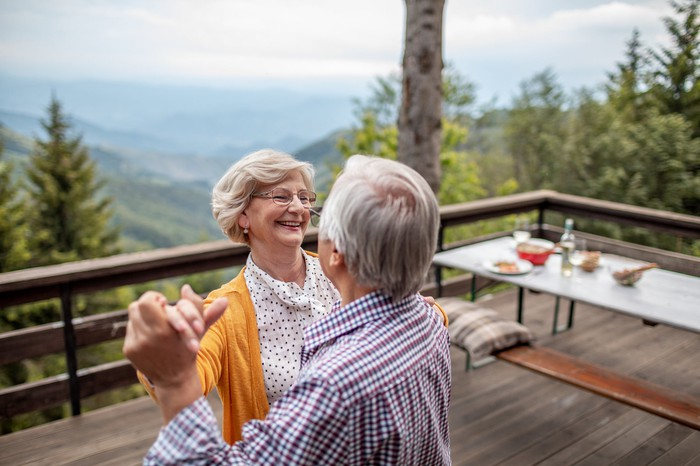 Elderly couple dancing together.
