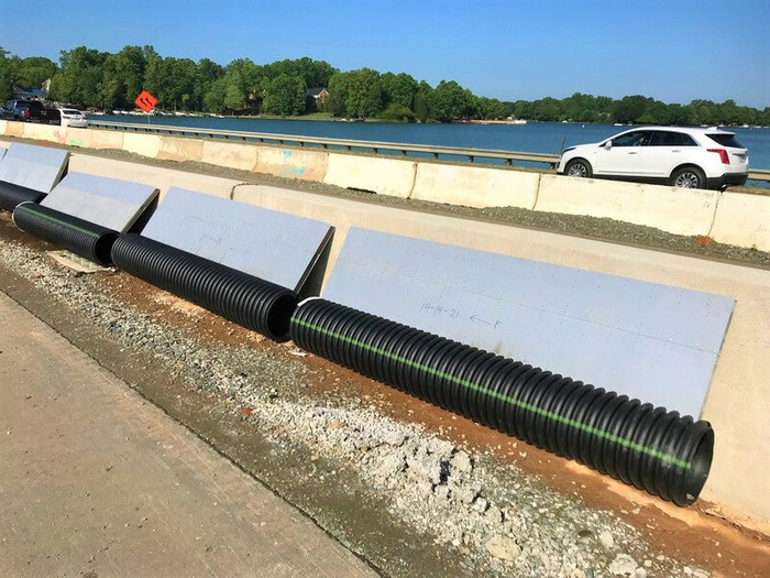 Corrugated plastic drainage piping at a highway jobsite.