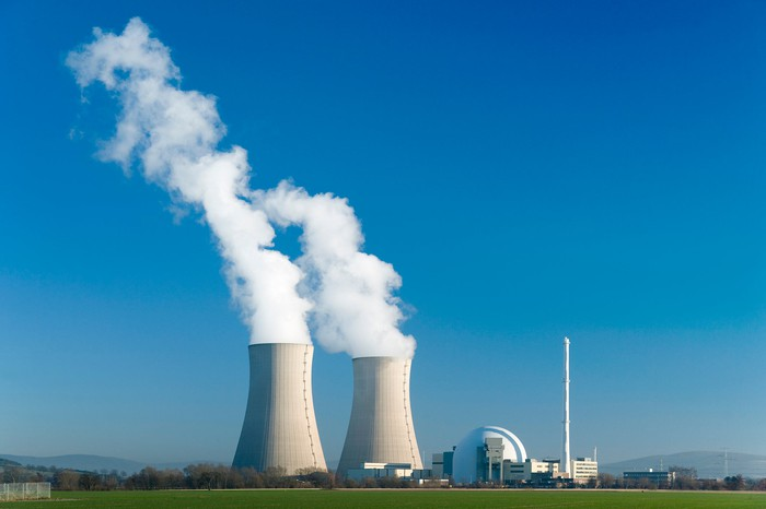 Steam rising from a pair of nuclear reactor cooling towers.