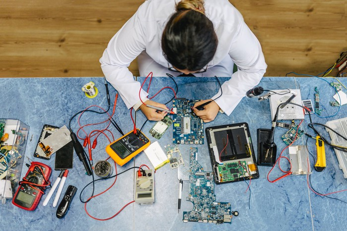 An electronic engineer working on integrated circuit boards.