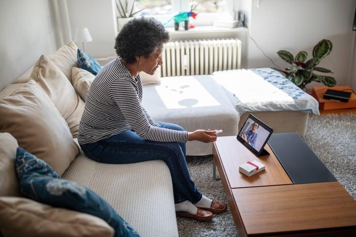 Elderly woman on a telehealth visit.