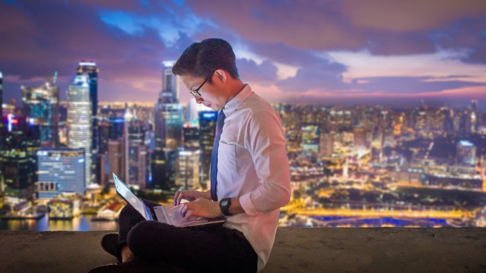 A person in Singapore uses a laptop.