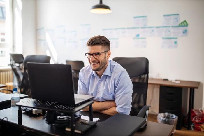 A man looking at a computer.