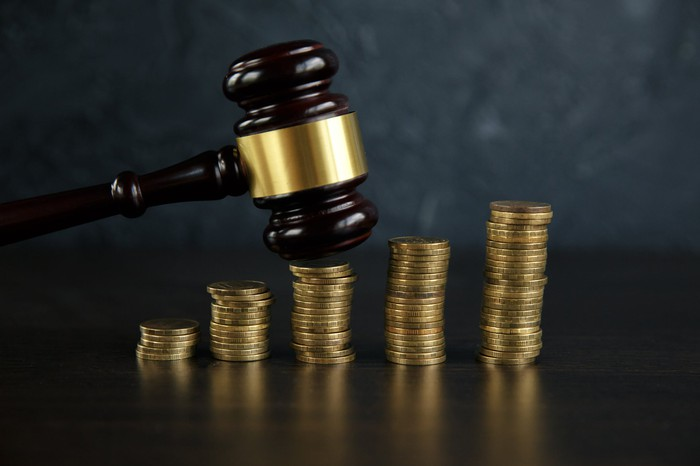 judge's gavel on coins representing cryptocurrency.