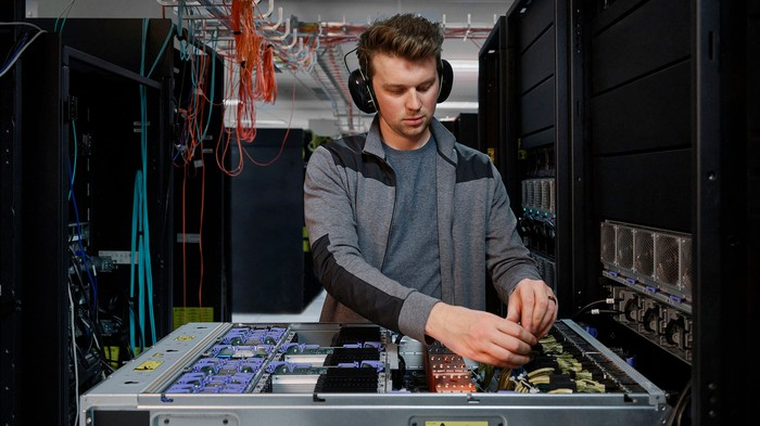 A person working on a Power E1080 server.
