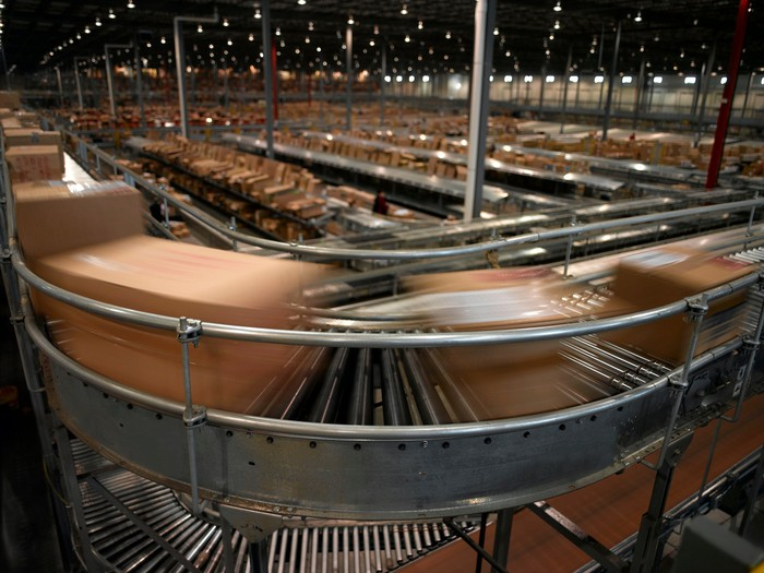 Packages flying by on high speed conveyor.