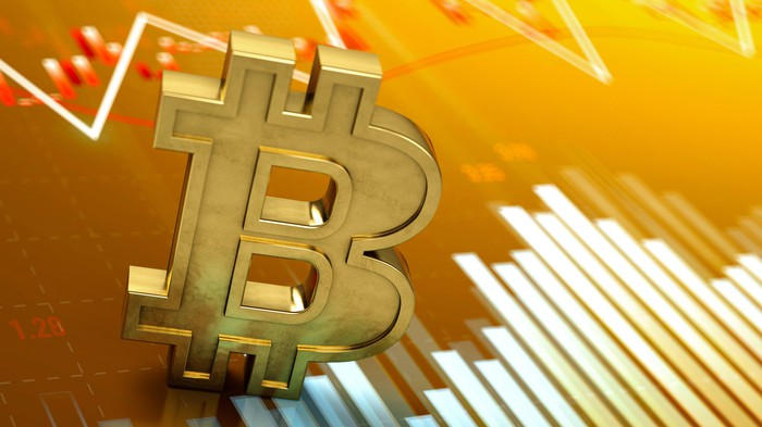 Gold Bitcoin symbol on a stock chart.