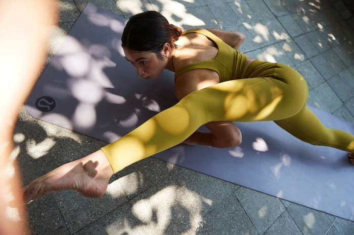 A person wearing Lululemon apparel while practicing yoga.