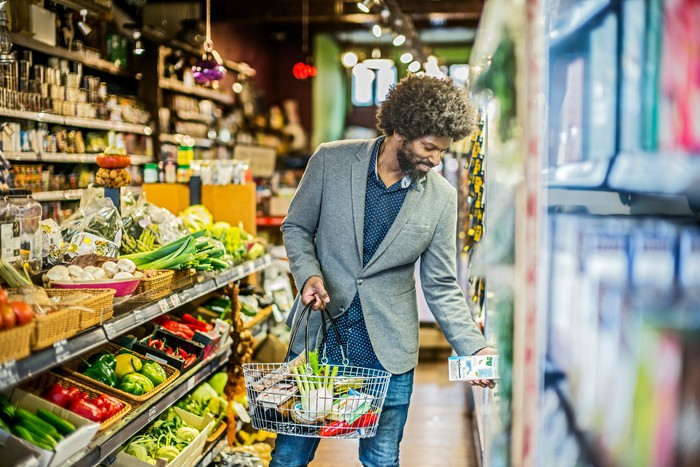 A person shopping for groceries in an organic health food store.