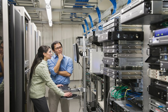 A woman and man in a server room.