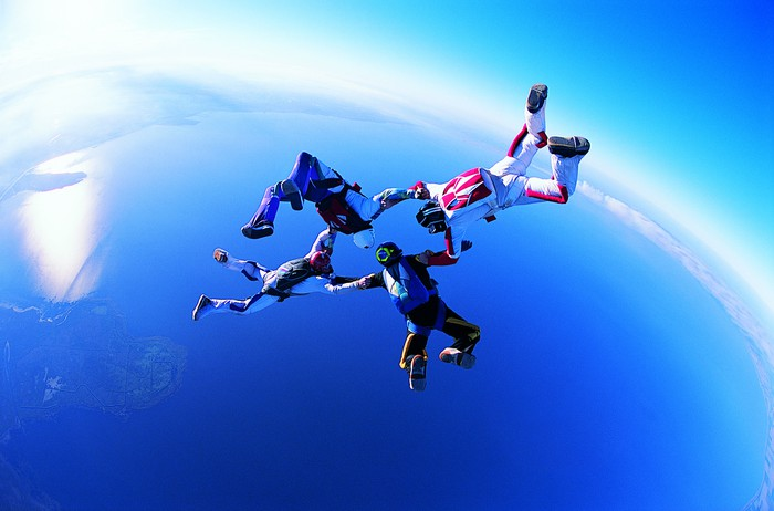 A group of four people on a tandem skydive.